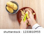 woman cook cleans potatoes ... | Shutterstock . vector #1233810955