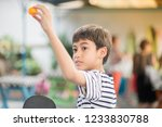 kid playing table tennis...   Shutterstock . vector #1233830788
