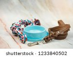 Stock photo leather leashes food bowls and pet bites pet supplies concept 1233840502