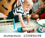 little kid playing with a... | Shutterstock . vector #1233856198