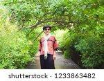 senior woman wear northern red... | Shutterstock . vector #1233863482