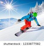 active man snowboarder riding... | Shutterstock . vector #1233877582