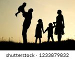 silhouette of a happy family...   Shutterstock . vector #1233879832