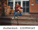 happy young mother hugs her... | Shutterstock . vector #1233904165