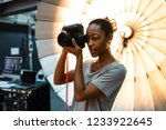 young photographer standing in... | Shutterstock . vector #1233922645