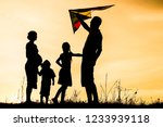 happy family playing on nature... | Shutterstock . vector #1233939118