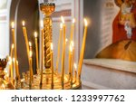 candles are burning  stand in... | Shutterstock . vector #1233997762