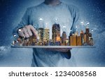 a man using digital tablet with ... | Shutterstock . vector #1234008568