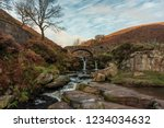 a waterfall and packhorse stone ... | Shutterstock . vector #1234034632