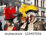 VENICE - 14 FEBRUARY: An unidentified man and two women masked in typical Venetian masks perform at the most famous European Carnival on February 14, 2010 in Venice. - stock photo