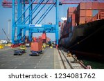 container ship in port at... | Shutterstock . vector #1234081762