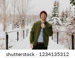 young trendy man in green... | Shutterstock . vector #1234135312