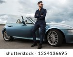successful  handsome man near... | Shutterstock . vector #1234136695