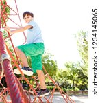 young child boy climbing on... | Shutterstock . vector #1234145065