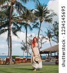 woman with red hair on vacation ...   Shutterstock . vector #1234145695