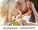 portrait of a couple in love... | Shutterstock . vector #1234147075