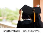 black graduates wear black... | Shutterstock . vector #1234187998