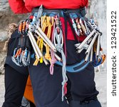 Ice climber equipped with all the necessary gear. - stock photo