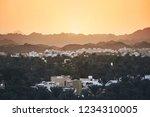 city against mountain range at... | Shutterstock . vector #1234310005