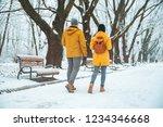 couple walking by snowed city... | Shutterstock . vector #1234346668