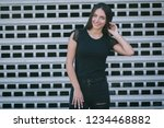 a brunette female with long... | Shutterstock . vector #1234468882