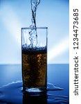 natural drink of dark yellow... | Shutterstock . vector #1234473685