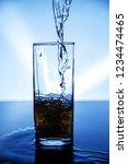natural drink of dark yellow... | Shutterstock . vector #1234474465