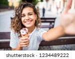 portrait of young woman eating...   Shutterstock . vector #1234489222