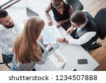 young employees sitting in the... | Shutterstock . vector #1234507888