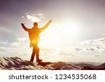 man stands in winner pose with... | Shutterstock . vector #1234535068