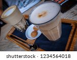 two perfect glasses of latte... | Shutterstock . vector #1234564018
