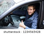 young man showing thumb up... | Shutterstock . vector #1234565428