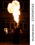Small photo of Grodno, Belarus - April, 30, 2012 fire show, fire blowing performance, dancing with flame, male master fakir with fire works on street arts festival, fire breathing trick
