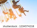 children ride on the carousel   Shutterstock . vector #1234574218