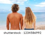 back view of young couple in... | Shutterstock . vector #1234586992