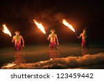 three maui men juggling fire in ... | Shutterstock . vector #123459442