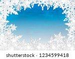 white snowflakes on blue... | Shutterstock . vector #1234599418