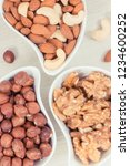 various nuts and almonds... | Shutterstock . vector #1234600252