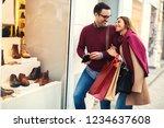 beautiful young couple enjoying ... | Shutterstock . vector #1234637608