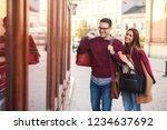 beautiful young couple enjoying ... | Shutterstock . vector #1234637692