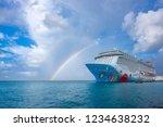 Small photo of Oranjestad, Aruba: November 5, 2018: A Colorful Cruise Ship Called Norwegian Breakaway, NCL, Docked at Oranjestad Harbor