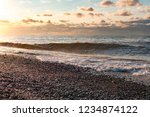 seashore with waves at sunset.... | Shutterstock . vector #1234874122