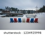 a series of adirondack chairs... | Shutterstock . vector #1234925998