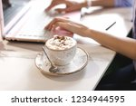 cup of coffee with marshmallows....   Shutterstock . vector #1234944595