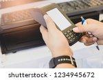 finger  on card machine on... | Shutterstock . vector #1234945672