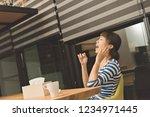 sick asian woman using tissue... | Shutterstock . vector #1234971445