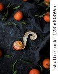 peeled mandarin orange with... | Shutterstock . vector #1235003965