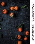 fresh ripe tangerines with... | Shutterstock . vector #1235019922