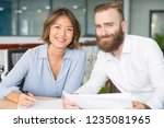 cheerful analysts working on... | Shutterstock . vector #1235081965