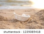 a foam is on the beach.dirty... | Shutterstock . vector #1235085418